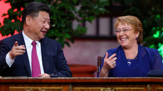Chile's President Michelle Bachelet and China's President Xi Jinping smiles before a signing bilateral agreements during a meeting at the government house in Santiago, Chile, November 22, 2016.