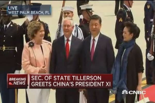 Treasury Secretary Tillerson greets Chinese President Xi Jinping