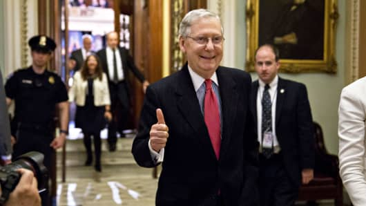 Senate Majority Leader Mitch McConnell, a Republican from Kentucky, gives a thumbs up while walking out of the Senate floor after passing a 'nuclear option' rule change at the U.S. Capitol in Washington, D.C., on Thursday, April 6, 2017.