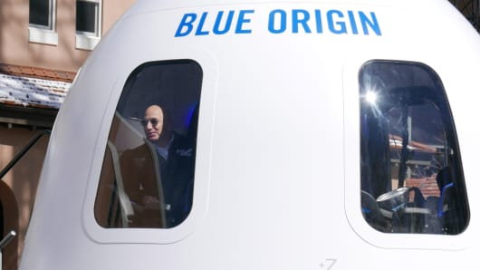 Jeff Bezos looks out of his Blue Origin capsule on April 5, 2017.