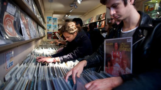 Young people look through vinyl records.