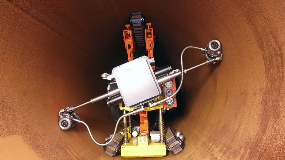 The robot can grow and shrink to fit into any size pipe.