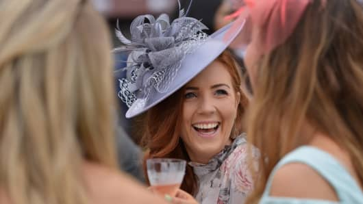 A guest wearing a hat arrives at the Meydan Racecourse to attend the Dubai World Cup day horse racing event.