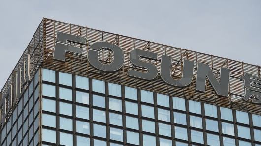 The logo of Chinese conglomerate Fosun is seen on top of a building in Beijing on December 12, 2015.