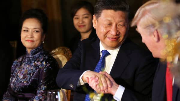 Chinese President Xi Jinping shakes hands with U.S. President Donald Trump as he is accompanied by China's first lady Peng Liyuan during a dinner at the start of a summit between President Trump and President Xi at Trump's Mar-a-Lago estate in West Palm Beach, Florida, April 6, 2017.