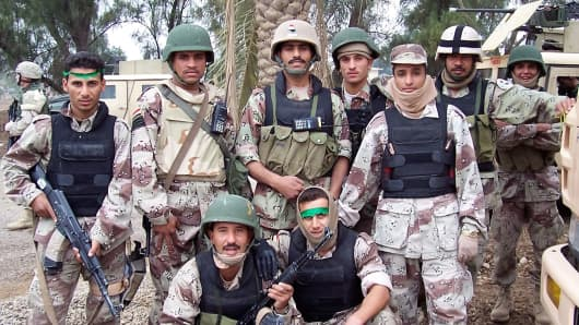 Iraqi troops trained by U.S. military advisors just before the Second Battle of Fallujah, 2004.