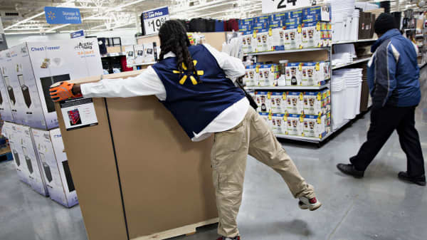 An employee unpacks merchandise at a Walmart location in Chicago.
