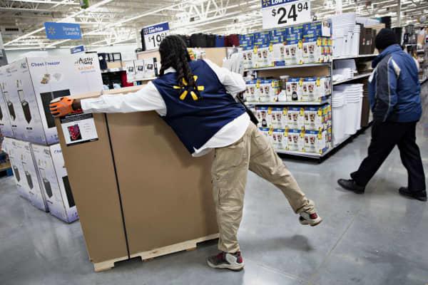 An employee unpacks merchandise at a Walmart location in Chicago.