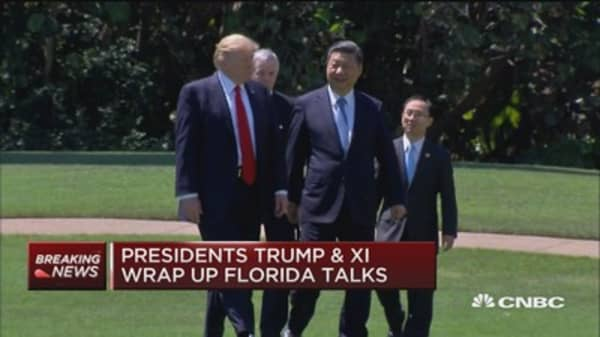 President Trump and China's Xi pose for cameras as they wrap up meeting