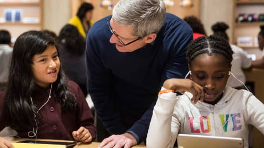 Tim Cook, CEO of Apple, visits an Apple store where third grade children from PS 57 James Weldon Johnson Leadership Academy are learning how to code through Apple's 'Hour of Code' workshop program on December 9, 2015 in New York City.