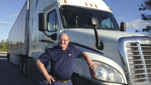 Bob Wyatt, who has driven more than 4 million miles over four decades for truck firm Schneider National, is pictured outside the company's headquarters in Green Bay, Wisconsin.