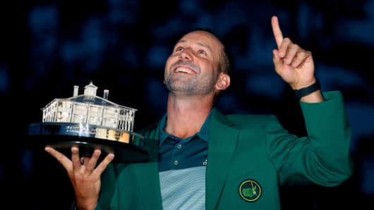 Sergio Garcia of Spain celebrates with the trophy during the green jacket ceremony after he won in a playoff during the final round of the 2017 Masters Tournament at Augusta National Golf Club on April 9, 2017 in Augusta, Georgia.