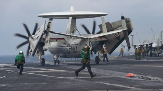 An E-2C Hawkeye lands on the deck of the USS Carl Vinson aircraft carrier during a South Korea-US joint military cxercise in seas east of the Korean Peninsula on March 14, 2017. The Carl Vinson Strike Group is participating in the annual joint Foal Eagle exercise between South Korea and the US.