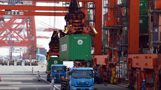 Containers are loaded onto a freighter at a pier of Tokyo port in Japan.