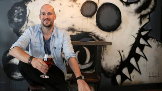 James Watt, chief executive officer of Brewdog Plc, poses for a photograph at the company's bar in Shoreditch, London, U.K.