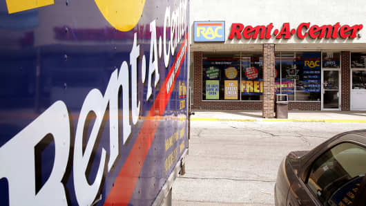 Rent-A-Center signage is seen on a truck parked outside its store in Niles, Illinois.