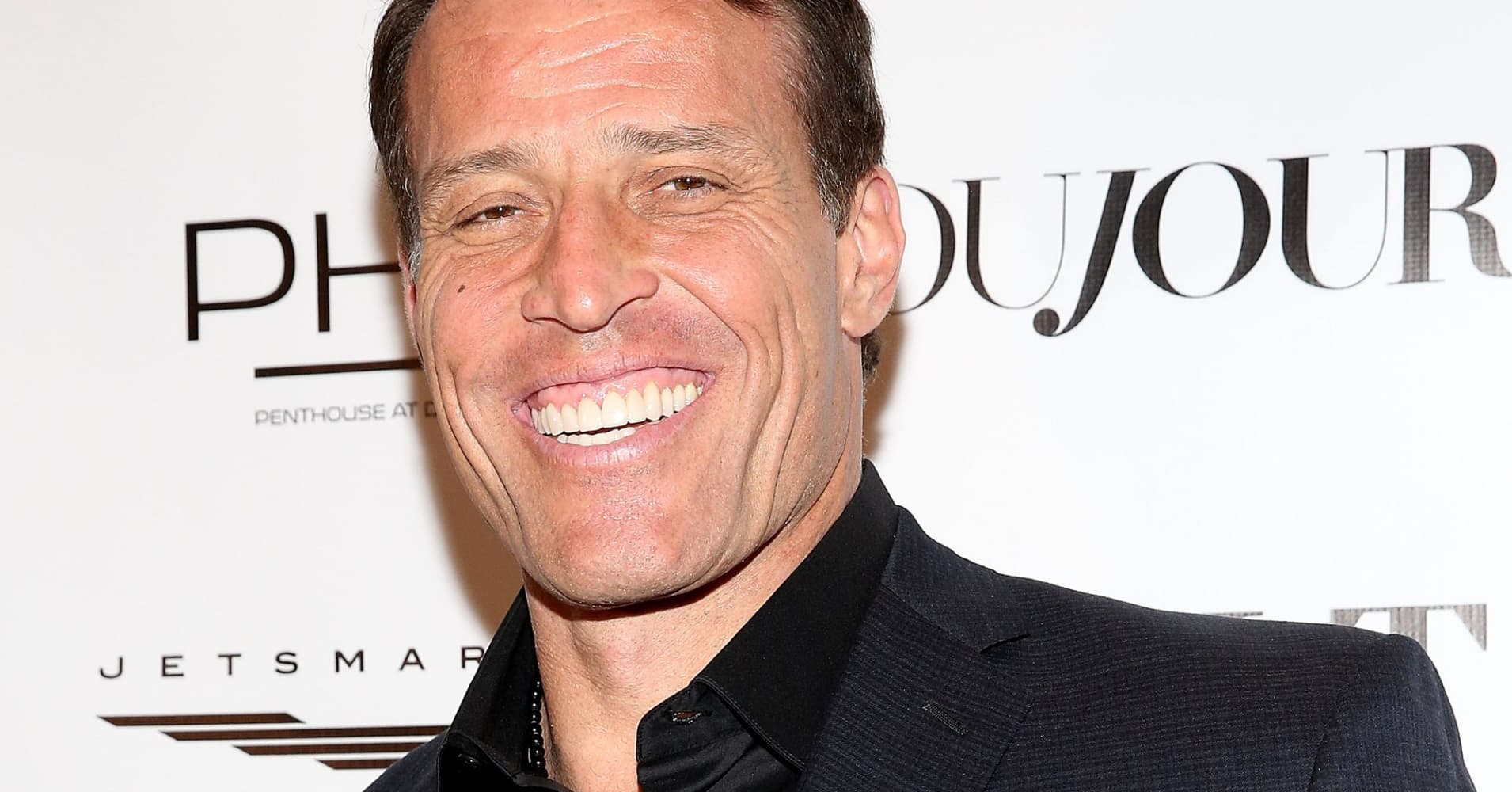Tony Robbins attends his 'Unshakeable' Book Launch Party & Birthday Celebration.