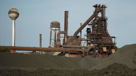 Mounds of coking coal sit piled near the blast furnace at the AK Steel mill in Middletown, Ohio.