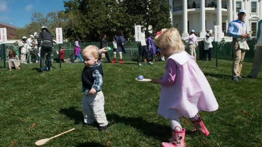 Children roll eggs at the annual Easter Egg Roll at the White House in Washington, DC, on March 28, 2016.