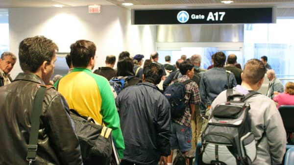 Passengers boarding a plane.