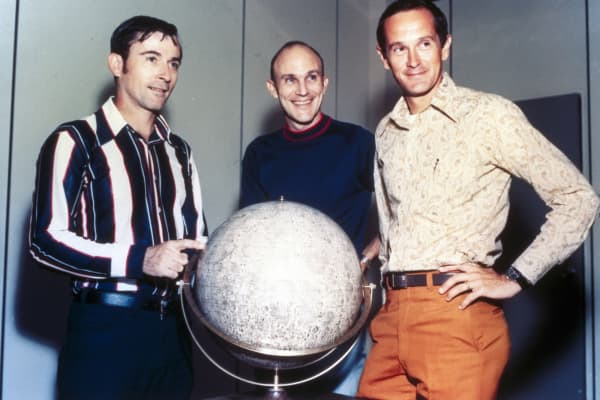 Apollo 16 astronauts Thomas Mattingly, John Young and Charles Duke with a lunar globe in 1972.