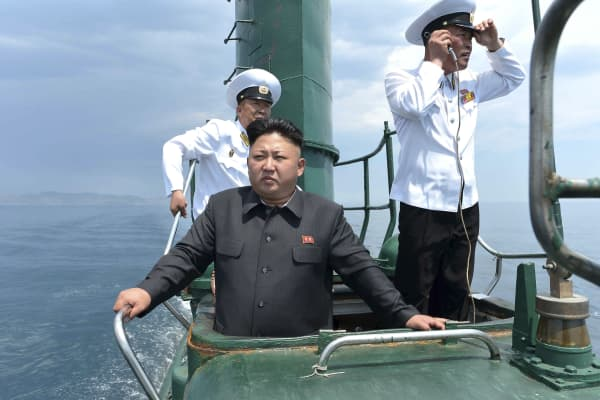 North Korean leader Kim Jong Un (front) stands on the conning tower of a submarine during his inspection of the Korean People's Army (KPA) Naval Unit 167 in this undated photo released by North Korea's Korean Central News Agency (KCNA) in Pyongyang.