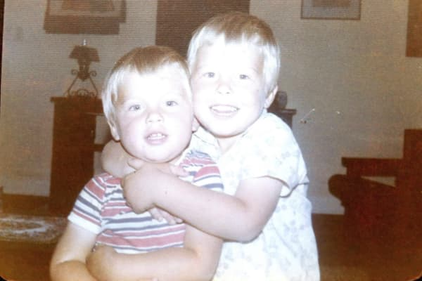 Three-year-old Elon Musk (Right) hugs his younger brother, Kimbal, in their childhood home in South Africa.