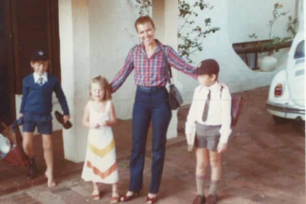 Kimbal, Tosca, and Elon Musk (Right) pose with their mother, Maye, before school in a childhood photo.