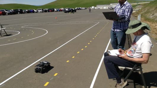 An autonomous vehicle races around the track at a DIY Robocar race at Thunderhill Raceway Park in Northern California, April 1 2017