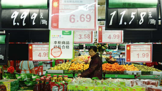 Customers purchase goods at a supermarket on December 9, 2016 in Hangzhou, China.