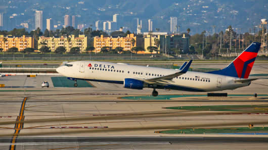 Delta Airlines Boeing 737 taking off from LAX in Los Angeles, California.