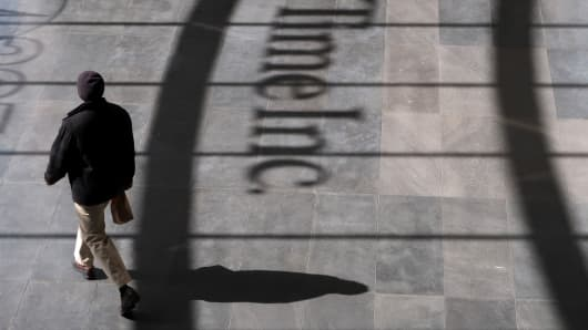 A person walks past the logo of Time Inc. in the lobby of their headquarters in lower Manhattan in New York City.