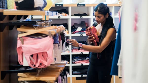 A customer looks at sports bras inside a Lululemon Athletica store.