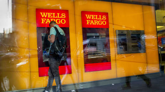 A man uses a Wells Fargo automated teller machine inside a bank branch in New York.