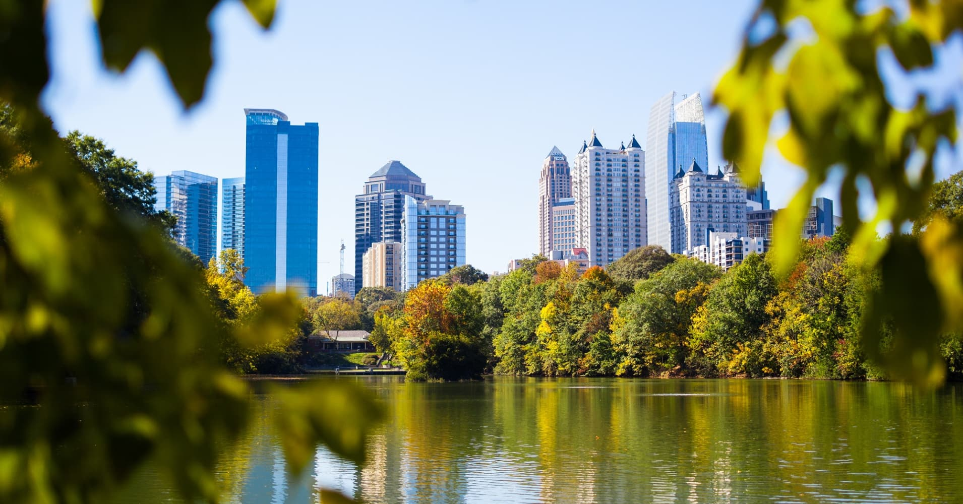 Atlanta reflected in the lake of Piedmont Park.