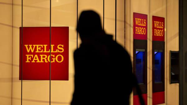 A pedestrian walks past a Wells Fargo bank branch in Washington, D.C.