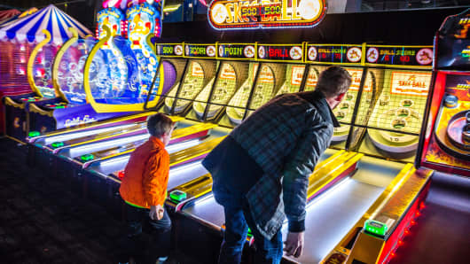Customers play skee ball at a Dave & Buster's Entertainment location in Pelham, New York.
