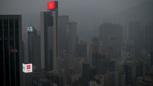 Smog haze hangs over the downtown business districts of Hong Kong on December 10, 2013.