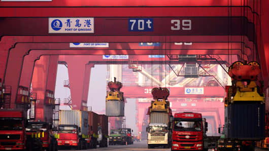 Trucks work in a port in Qingdao, China.