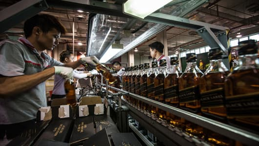 Employees box bottles of Johnnie Walker at Diageo Plc International Supply Center