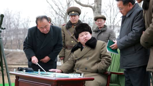 North Korean leader Kim Jong Un gives instruction during a simulated test of atmospheric re-entry of a ballistic missile, at an unidentified location in this undated photo released by North Korea's Korean Central News Agency (KCNA) in Pyongyang on March 15