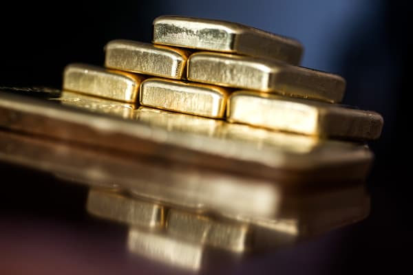 Two hundred and fifty gram gold bars sit stacked in a pile