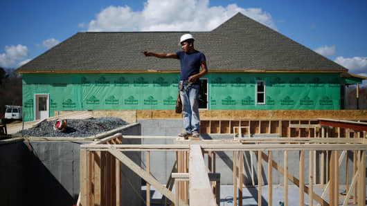 A contractor works on the basement of a home under construction in the Toll Brothers Regency at Palisades community in Charlotte, N.C.