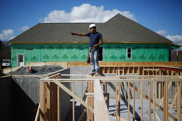 A contractor works on the basement of a home under construction in the Toll Brothers Regency at Palisades community in Charlotte, N.C., on Friday, Feb. 24, 2017.