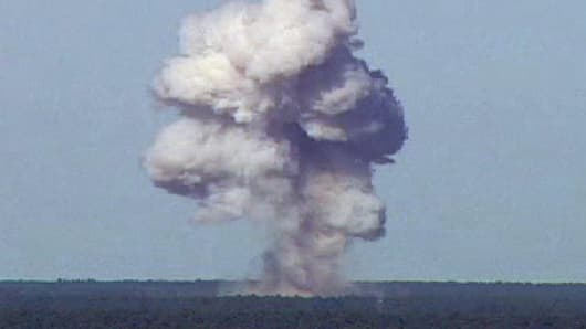 The GBU-43/B, also known as the Massive Ordnance Air Blast, detonates at Eglain Air Force Base in Florida on November 21, 2003. The 21,700-pound bomb was dropped from 20,000 feet to reach its target on one of Eglin's test ranges. Upon detonation, it created a plume that rose more than 10,000 feet over the Florida Panhandle.
