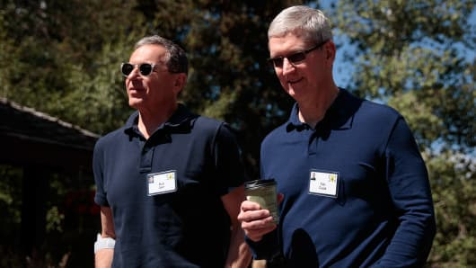 Bob Iger, chief executive officer of The Walt Disney Company, walks with Tim Cook, chief executive officer of Apple Inc. last July.