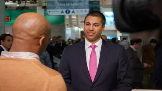 CNBC's Jon Fortt, shown from behind, speaks with FCC Chairman Ajit Pai on Friday. April 14, 2017.