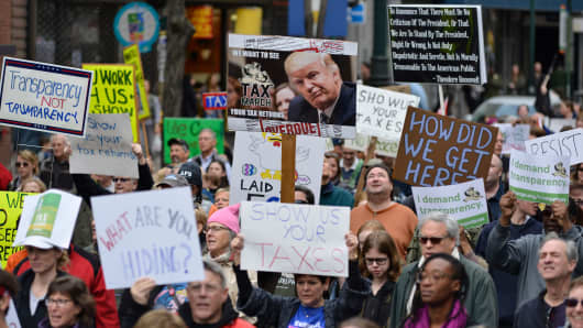 Protestors participate in a Tax Day March in Center City Philadelphia, on April 15, 2017.