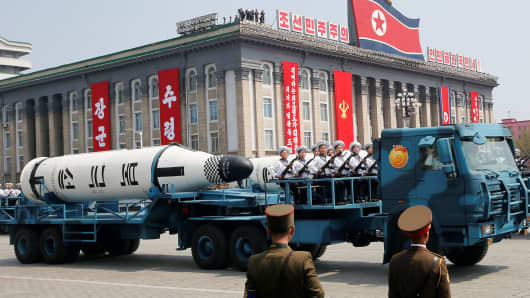Military vehicles carry missiles with characters reading 'Pukkuksong' during a military parade marking the 105th birth anniversary of North Korea's founding father, Kim Il Sung, in Pyongyang, April 15, 2017.