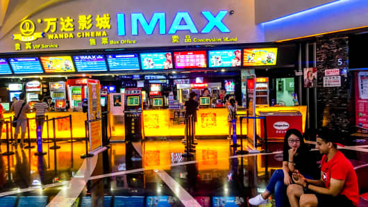 Customers buy tickets in a Wanda Imax cinema in Weifang, China.